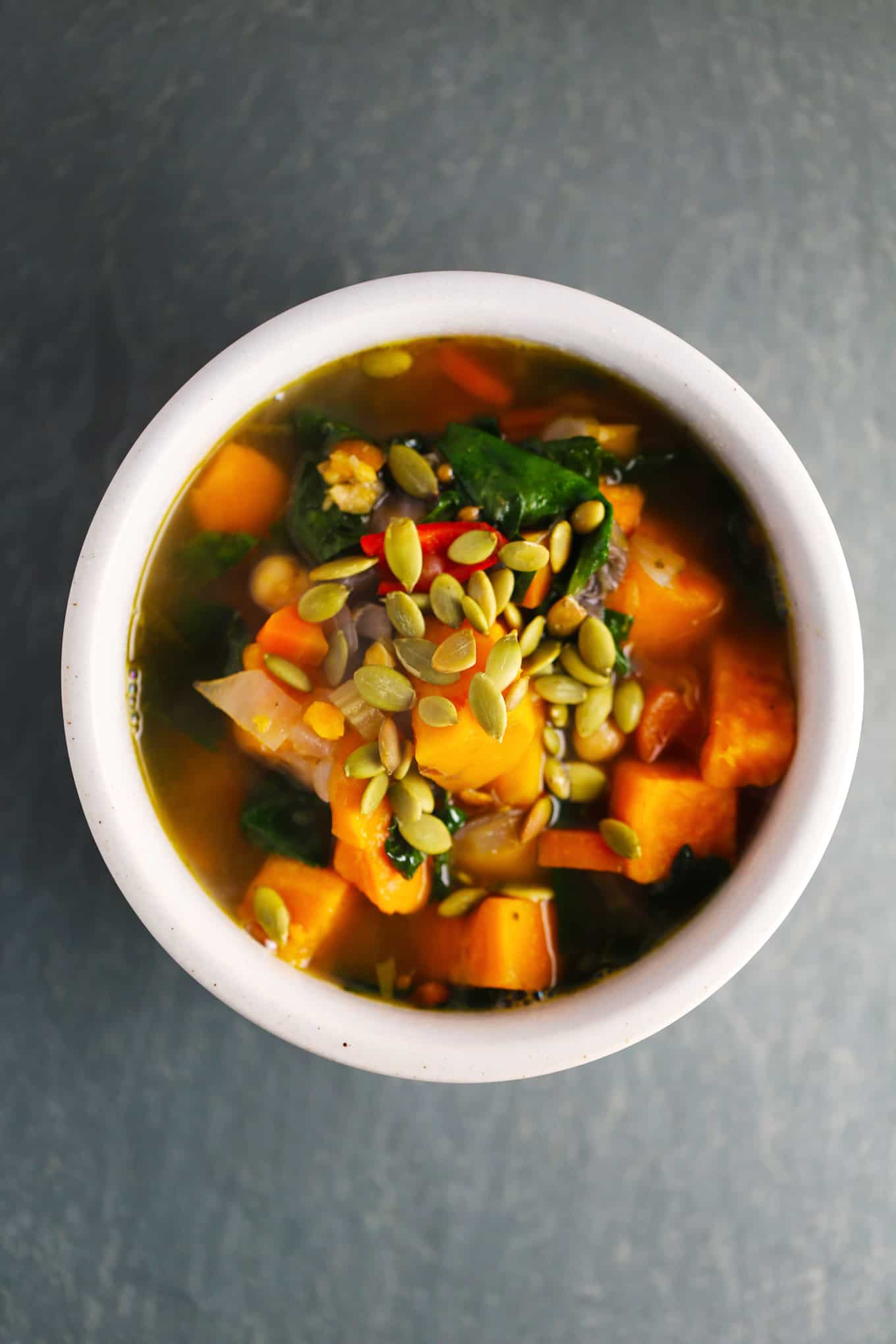 Chunky sweet potato and sweet pepper soup. Delicious low-calorie soup made sweet potatoes, sweet bell peppers, portobello mushrooms, kale, and chickpeas. Made simply in one pot in under an hour.